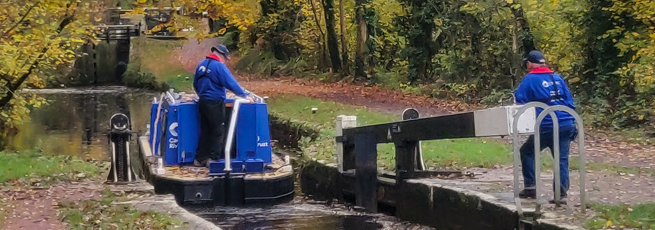 CRT workboat passing through Llangynidr Locks
