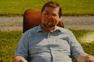 Bill  Ashman in a chair